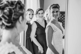 Bride and her bridesmaids admiring their reflection