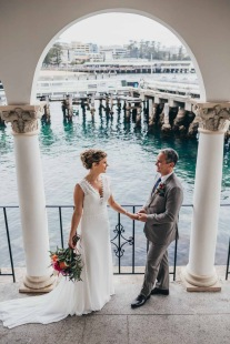 Bride and groom posed for seaside wedding portraits
