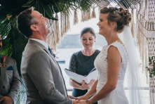 Groom laughing during the wedding ceremony