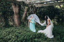 Bride and bridesmaid playing games under the veil